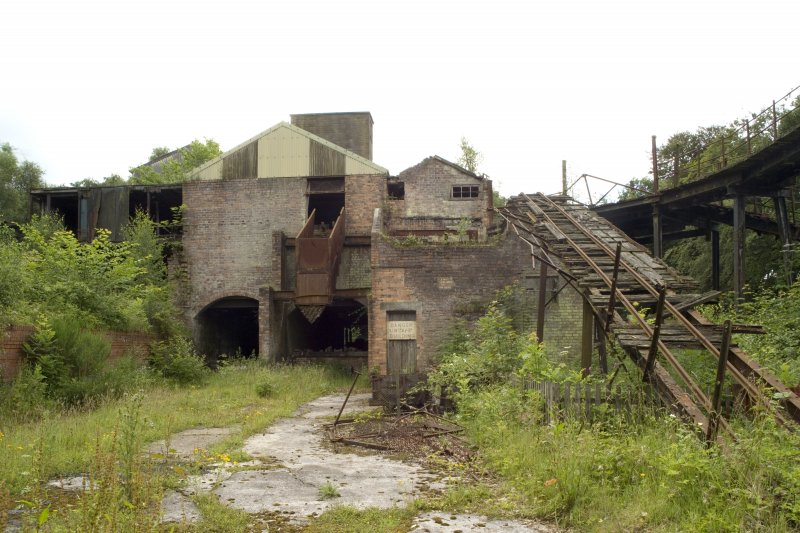 Mine Surface Buildings. View looking S towards loading bays, pan house and distribution area.
