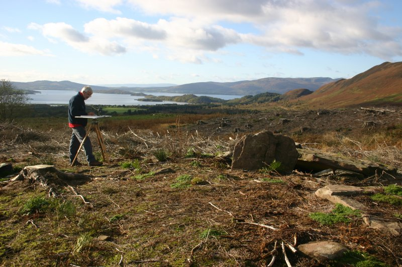 Ian Parker undertaking a plane table survey of the chambered cairn. View looking SW to Loch Lomond.
