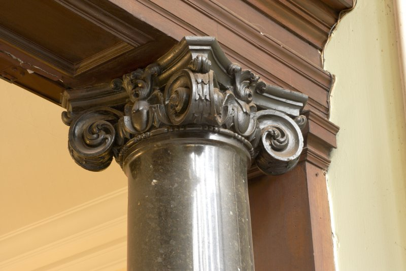 Interior. Detail of black marble column on ground floor showing corinthian capitals.