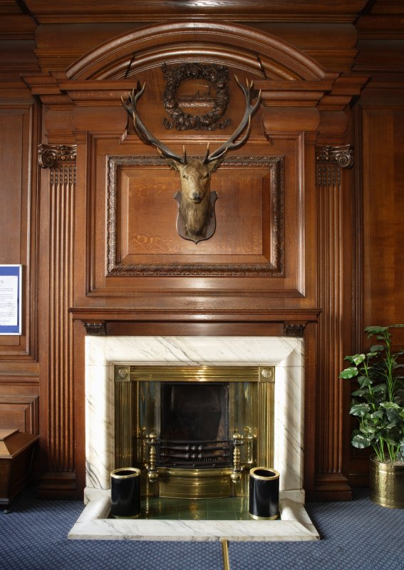 Interior. Detail of fireplace and chimney breast in boardroom on first floor.