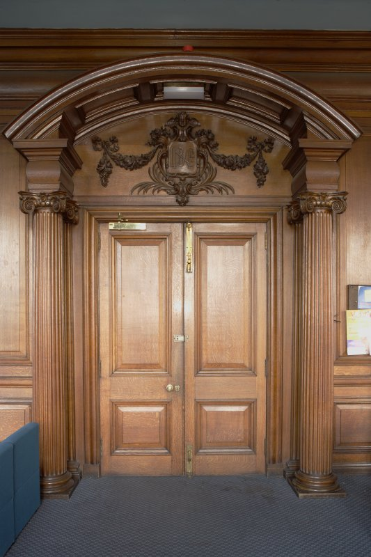 Interior. View of board room doors on first floor, from corridor.