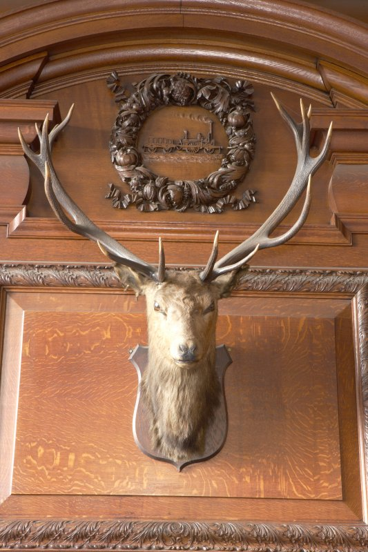 Interior. Detail of stags head and carving above fireplace in boardroom on first floor.