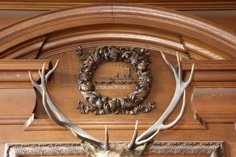 Interior. Detail of carving above fireplace in boardroom on first floor.