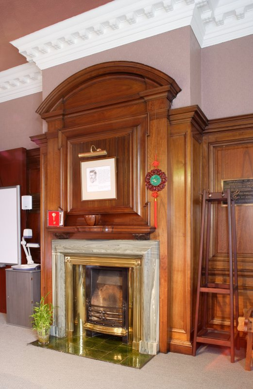 Interior. Detail of fireplace and chimney breast in directors board room on second floor.
