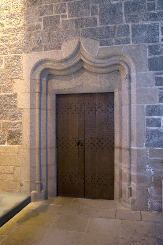 Interior. View of doorway in E side chapel leading to priest's house (door closed)