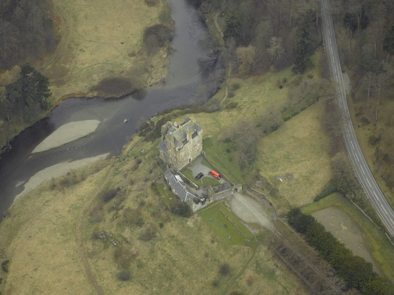 Oblique aerial view centred on the Castle/Tower-House and the outbuildings, gateway and part of walled garden, taken from the ESE.