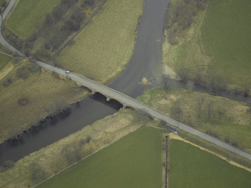 Oblique aerial view centred on Manor Bridge, taken from the SW.