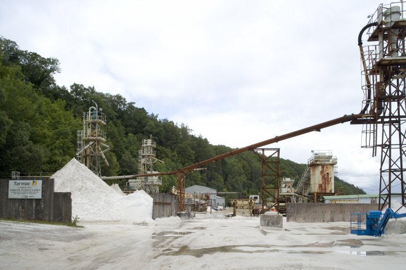 General view of pipe carrying crushed sand and clean water to the Eagle Screw plant and the flotation tanks to allow the separation of fines and standard sand stock.