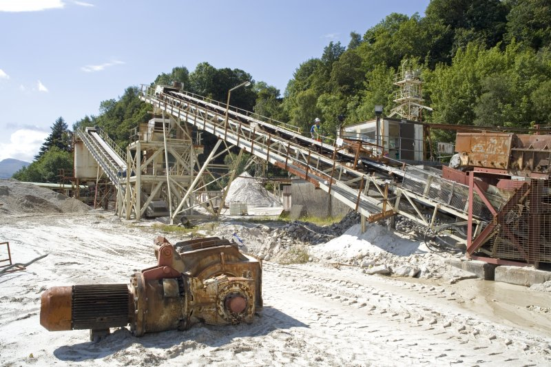 View from NE of primary crusher awaiting maintenance (foreground), Drag Feeder and Conveyors 1 and 2.
