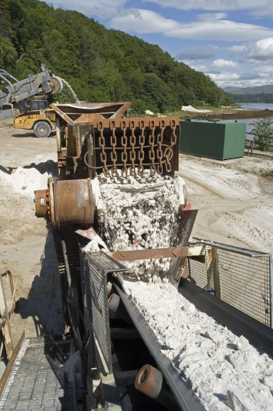 Elevated view from S of Drag Feeder, note the primary crushed material pouring from the mouth of the Drag Feeder onto Conveyor No. 1.