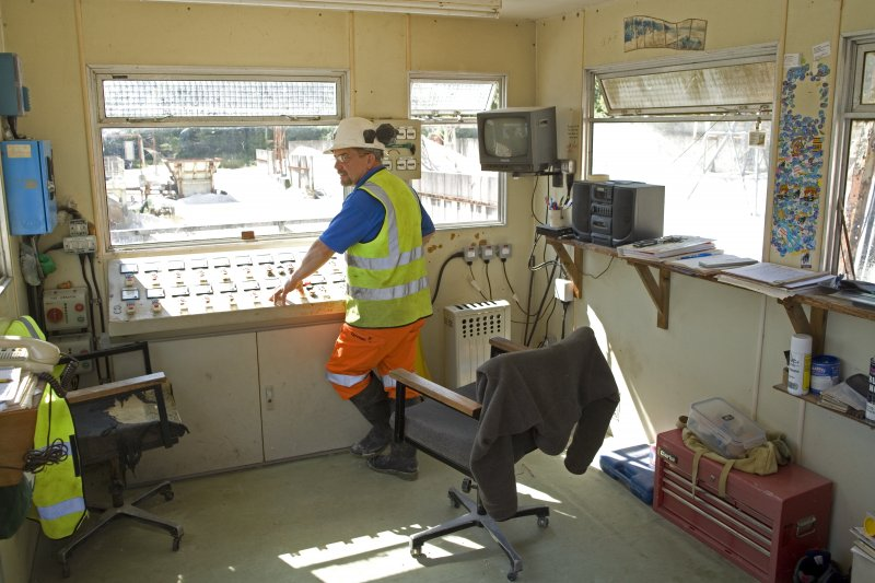 Interior. Control Cabin with Peter Lindsay, Plant Manager (native of Dundee, at Lochaline for 27 years).