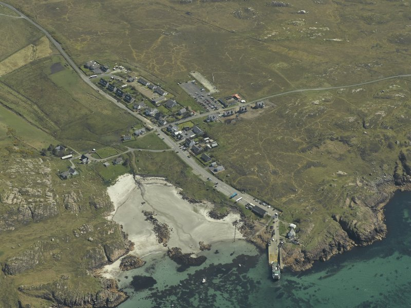 General oblique aerial view of the village and jetty, taken from the NW.