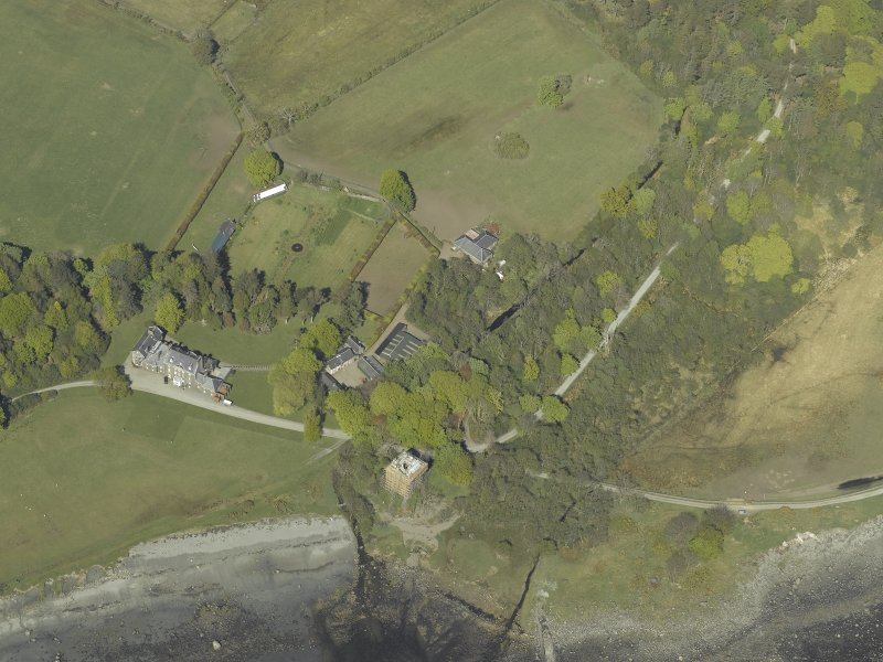 Oblique aerial view centred on the towerhouse, country house, walled garden and farmsteading, taken from the SSW.