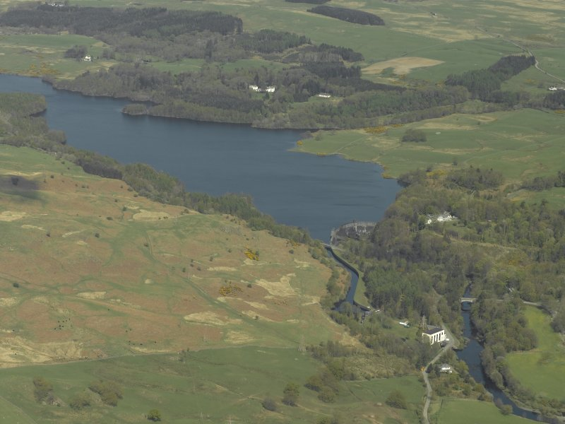 General oblique aerial view centred on the reservoir with the dam and the power station in the foreground, taken from the SSW.