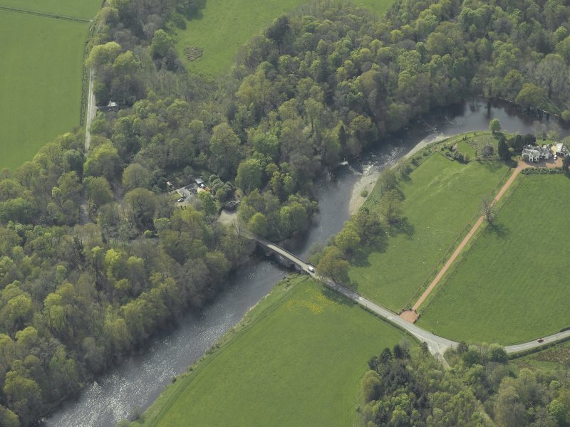 Oblique aerial view centred on the road bridge with the house adjacent, taken from the E.