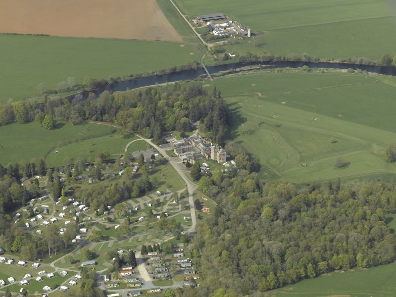 Oblique aerial view centred on the country house with the caravan park adjacent, taken from the SSE.