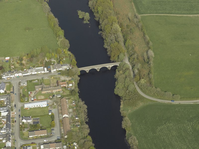 Oblique aerial view centred on the road bridge, taken from the ENE.