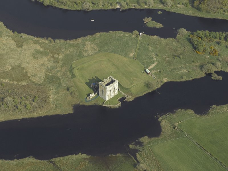 Oblique aerial view centred on the castle, taken from the W.