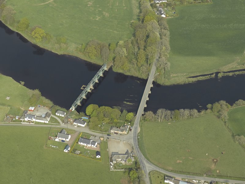 Oblique aerial view centred on the road bridge and barrage, taken from the WSW.