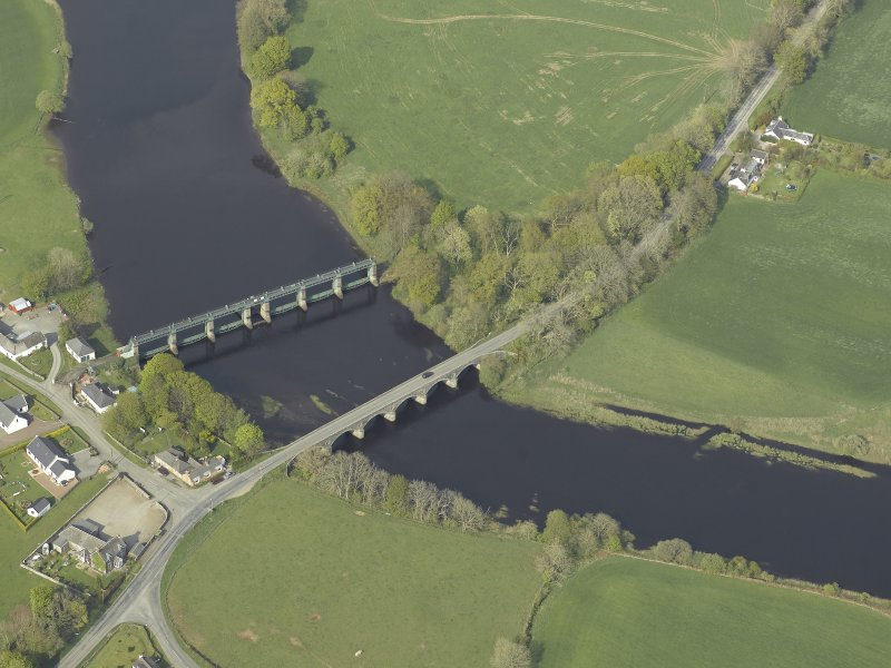 Oblique aerial view centred on the road bridge and barrage, taken from the SW.