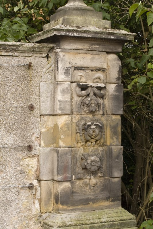 Detail of gate pier to NE of main house showing carved stonework from S.