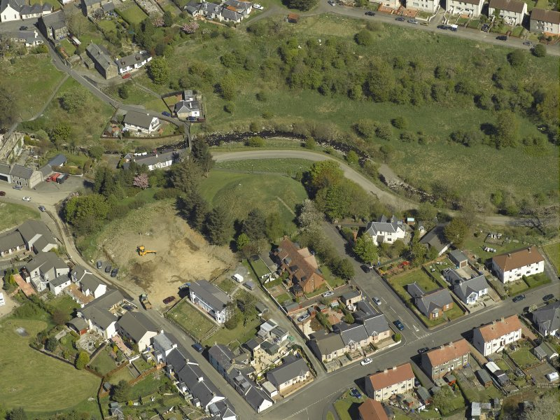 Oblique aerial view centred on the remains of the Motte, taken from the S.