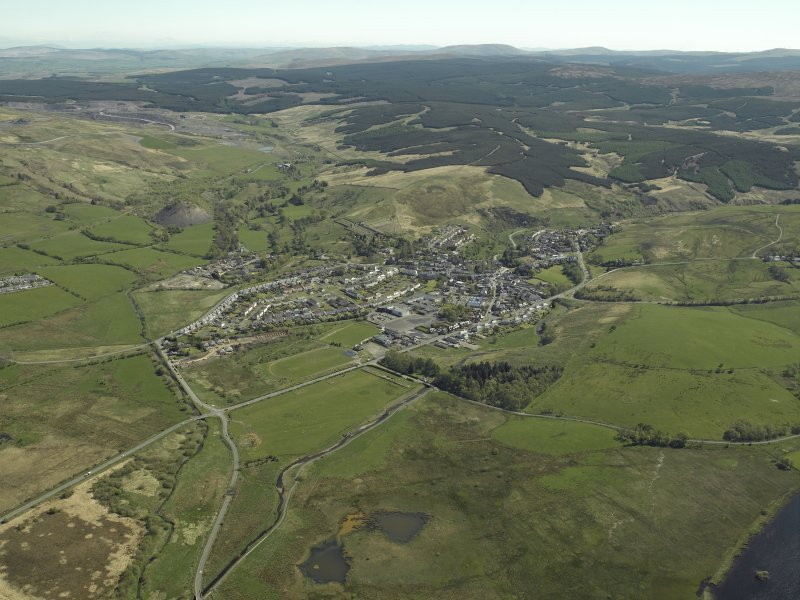 General oblique aerial view looking towards the village of Dalmellington, taken from the SW.