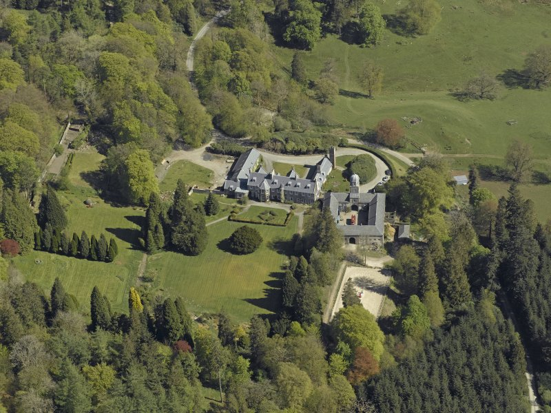 Oblique aerial view centred on Craigengillan House and Stables, taken from the SW.