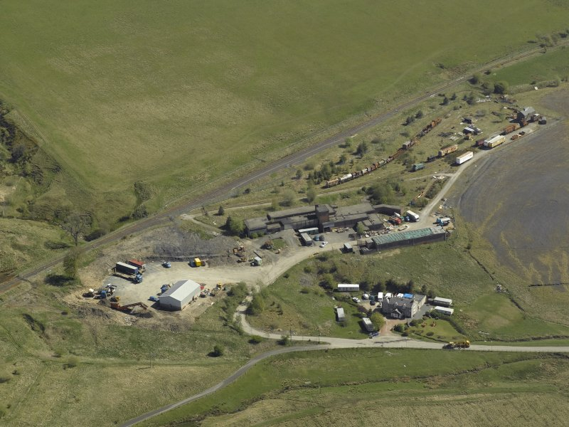 General oblique aerial view centred on the remains of the Minnivey Colliery (now the Scottish Industrial Railway Centre) with the mineral railway in the background, taken from the WSW.