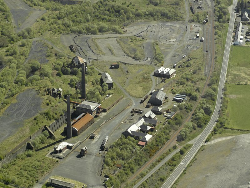 Oblique aerial view of the remains of the ironworks, taken from the WNW.