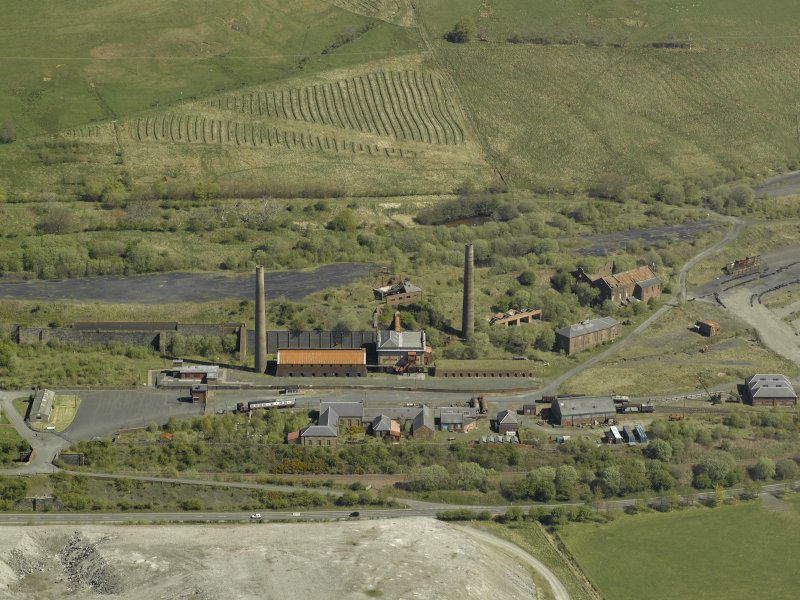 Oblique aerial view of the remains of the ironworks, taken from the SSW.