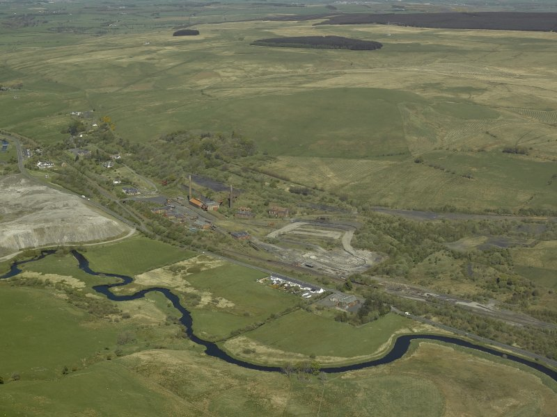 General oblique aerial view centred on the ironworks with the bing adjacent, taken from the SW.