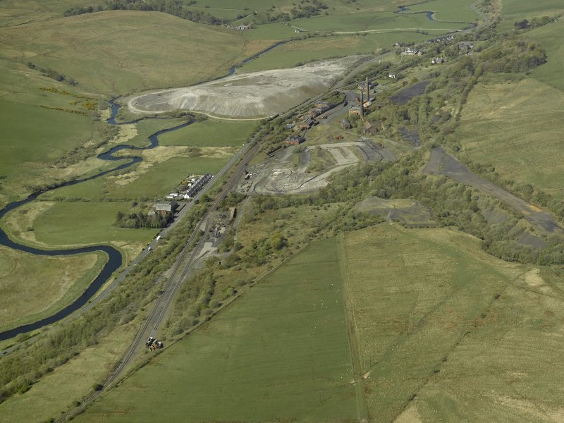 General oblique aerial view centred on the remains of Minnivey Colliery (now the Scottish Industrial Railway Centre) with the mineral railway in the foreground, taken from the ENE.