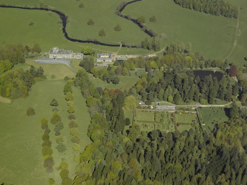 Oblique aerial view centred on the walled garden with Blairquhan House and stable block adjacent, taken from the S.