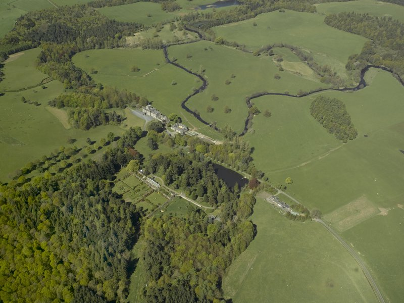 Oblique aerial view centred on the walled garden with Blairquhan House and stable block adjacent, taken from the SE.