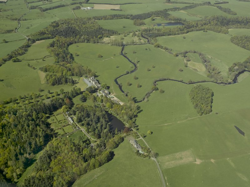 Oblique aerial view centred on the walled garden with Blairquhan House and stable block adjacent, taken from the E.