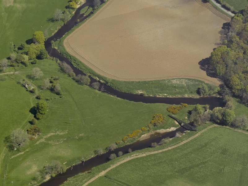 General oblique aerial view centred on the remains of Waulkmill, taken from the SW.