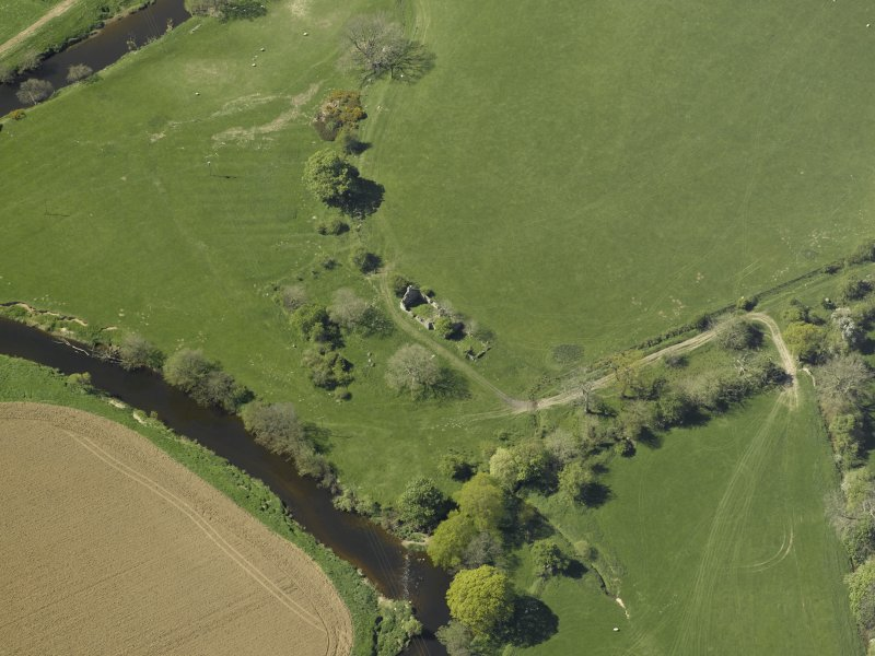 General oblique aerial view centred on the remains of Waulkmill, taken from the NE.