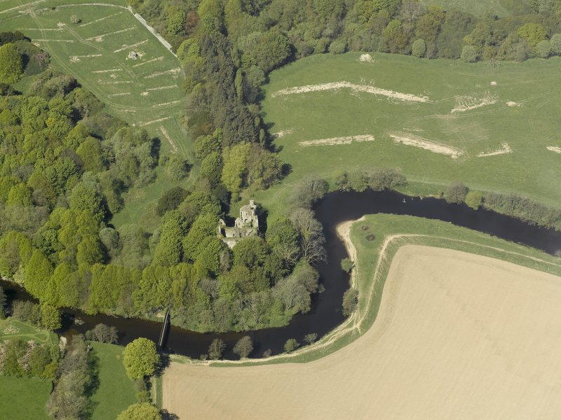 Oblique aerial view centred on the remains of the old castle, taken from the SE.
