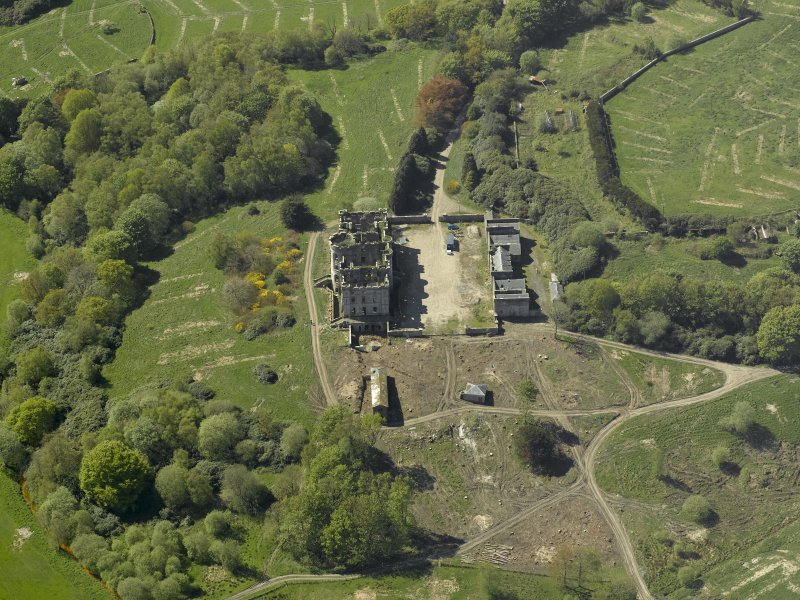 Oblique aerial view centred on the ruins of the country house, taken from the NE.