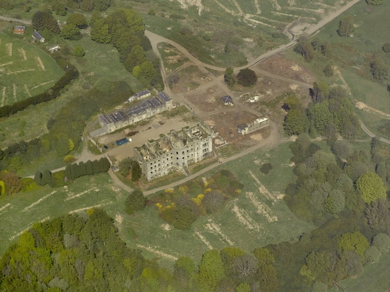 Oblique aerial view centred on the ruins of the country house, taken from the SSE.