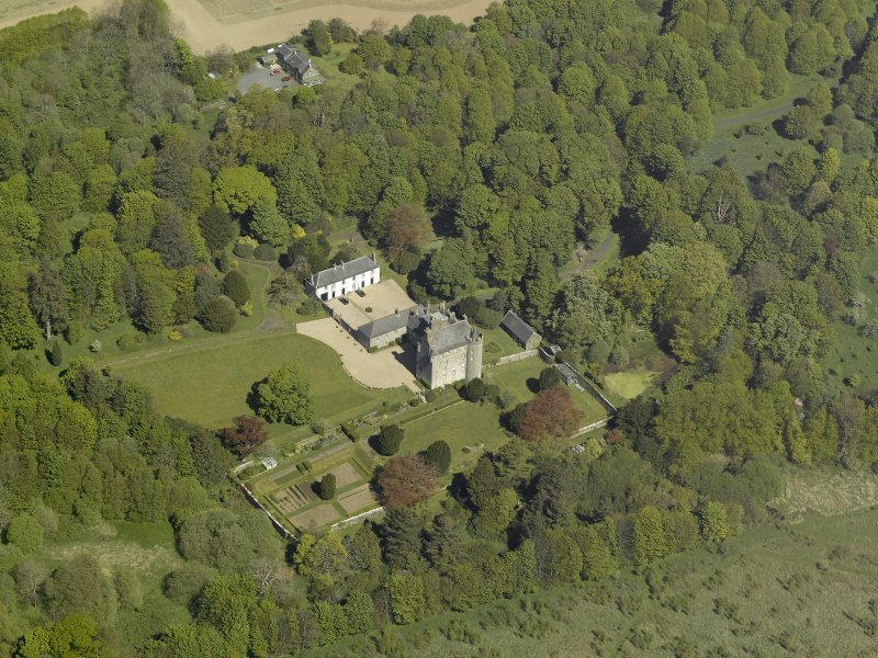 Oblique aerial view centred on the castle and country house, taken from the S.