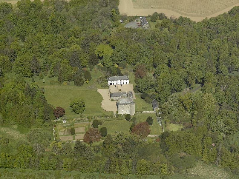 Oblique aerial view centred on the castle and country house, taken from the SSE.