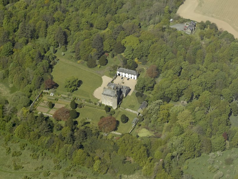 Oblique aerial view centred on the castle and country house, taken from the SE.