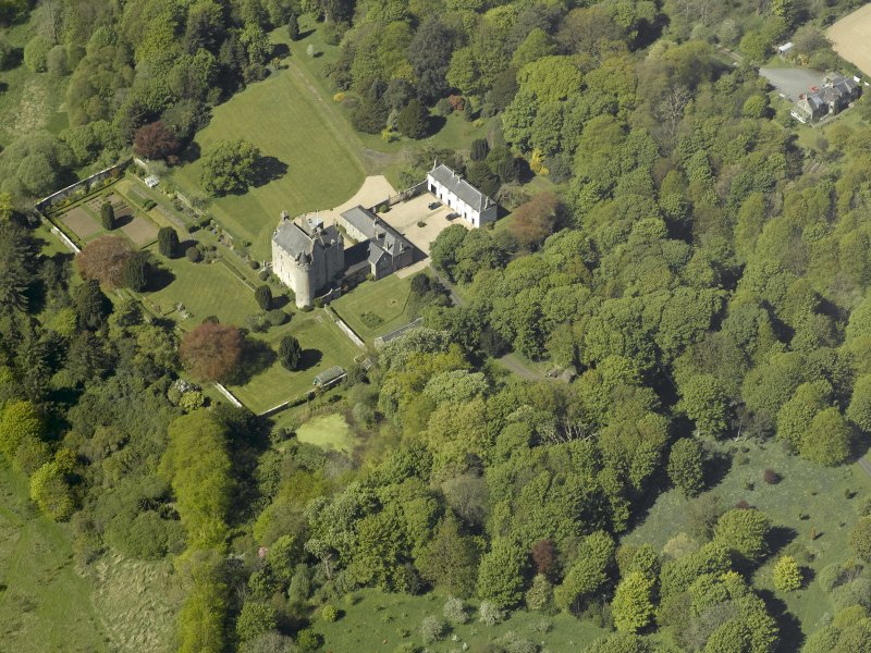 Oblique aerial view centred on the castle and country house, taken from the E.