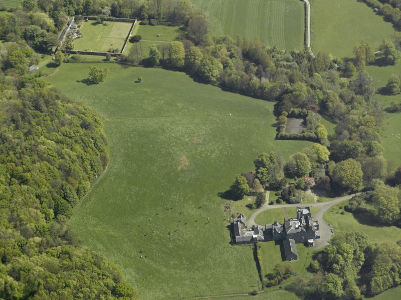 General oblique aerial view of the castle, country house and walled garden, taken from the WSW.