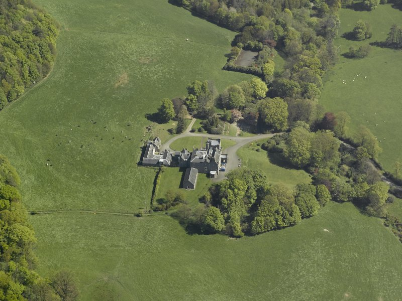 General oblique aerial view of the castle and country house, taken from the SW.