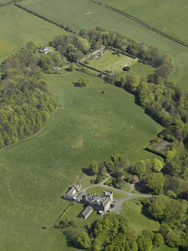 General oblique aerial view of the castle, country house and walled garden, taken from the SW.