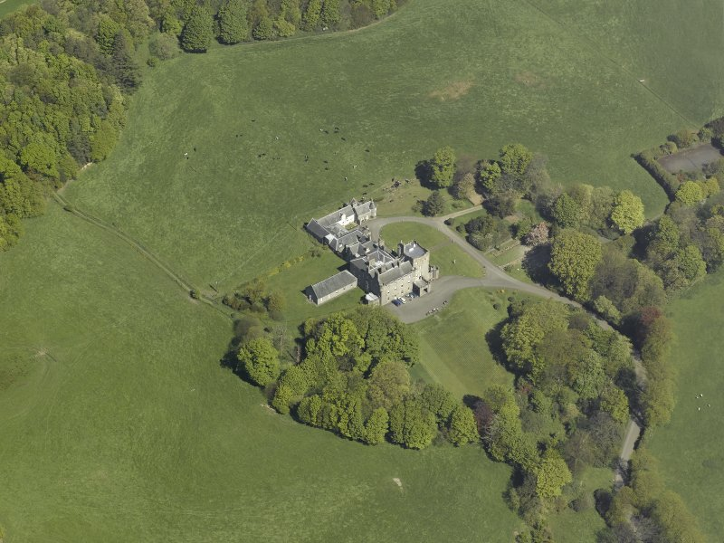 General oblique aerial view of the castle and country house,  taken from the S.