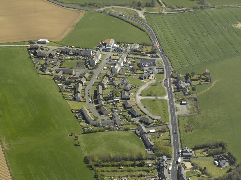 General oblique aerial view of the village, taken from the W.
